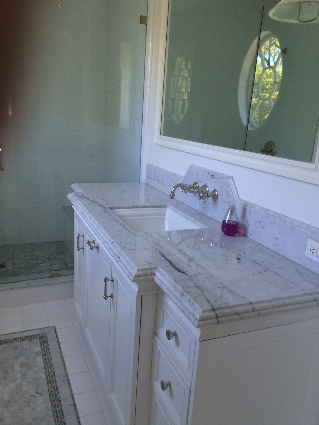 Custom vanity and medicine cabinet with leg details and side panels