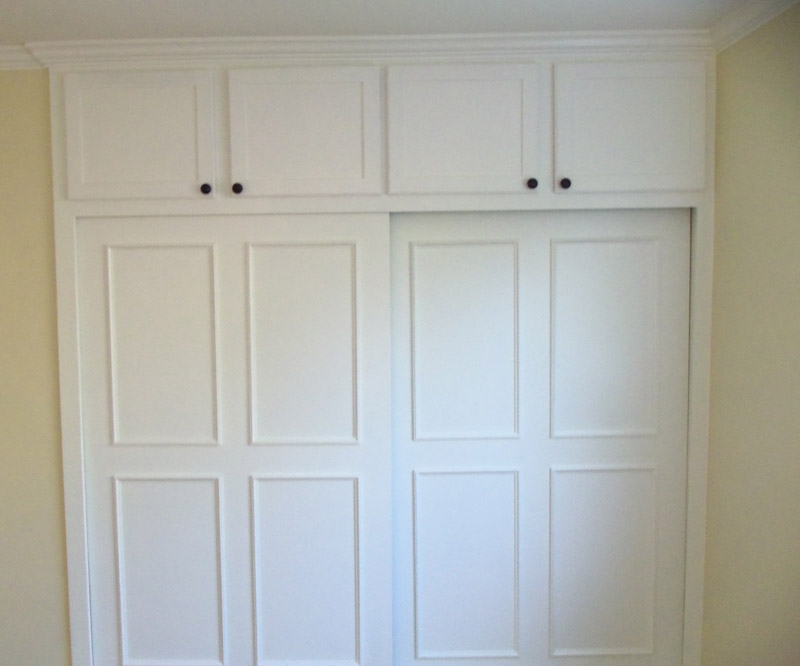 Built-in closet with by-pass doors