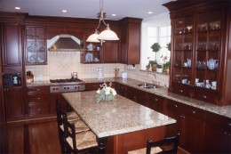 cherry stained cabinets with custom made columns