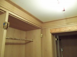 Closet with brass poles