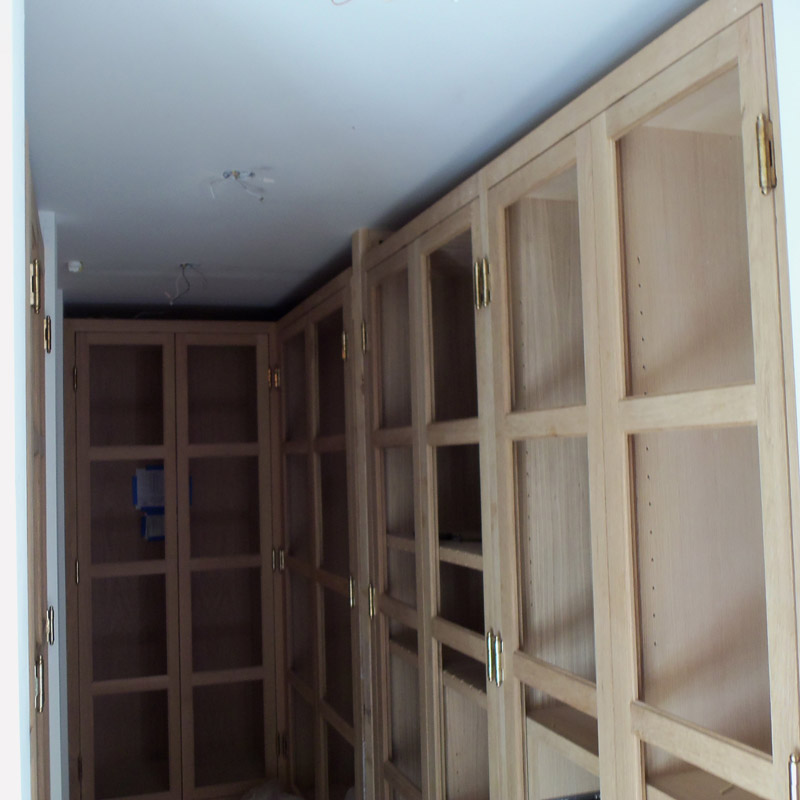 Closet cabinets in rift with oak before stains & glass