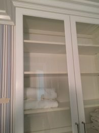 Linen closet with glass doors