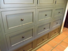 Drawers of kitchen island with maple distressed butcher block