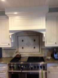 Custom kitchen hood with custom made corbels - San Marino residence