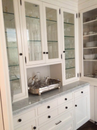Custom walk–in plate storage with glass doors - Holmby residence