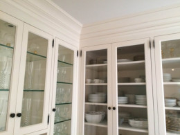 Kitchen cabinets with made top island glass doors - Holmby residence