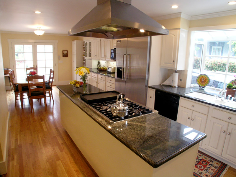 Kitchen with island cook top ideal cabinets inc Kitchen design center stove