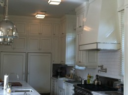 Kitchen with custom chimney hood
