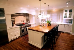 Kitchen with island and built in plaster hood