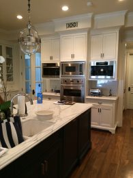 Kitchen with custom island and hood - Pacific Palisades residence