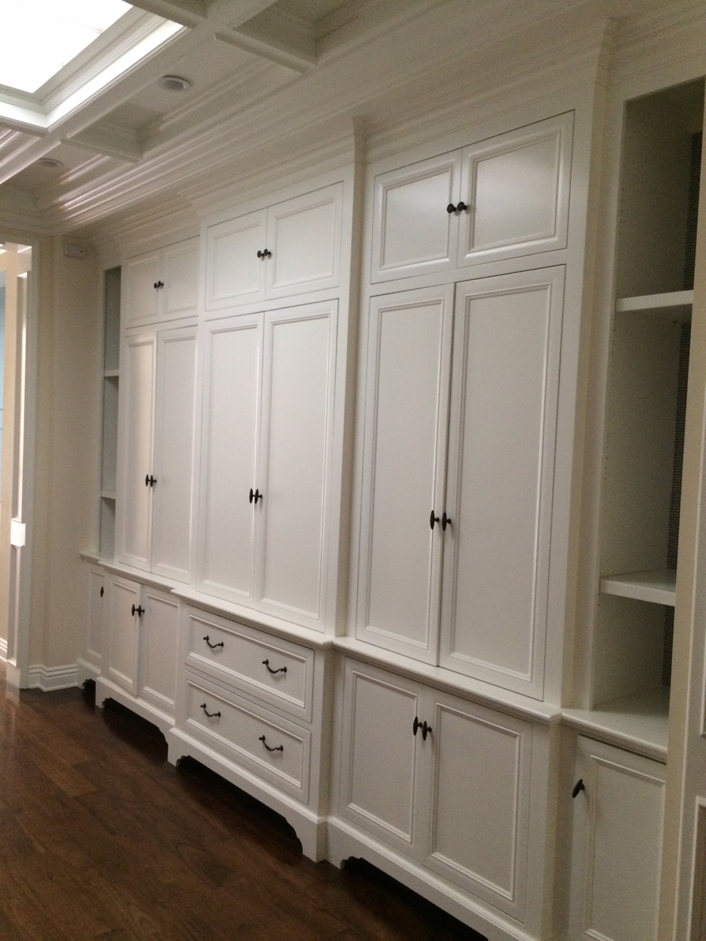 Custom linen closet with custom leg detail and beam & crown at ceiling