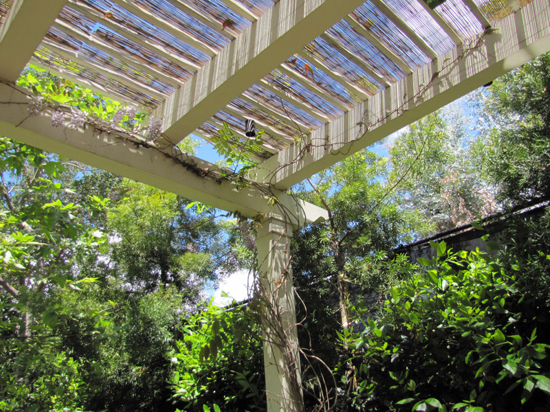 Pergola with trellis and outdoor fireplace alt view 1