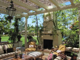 Pergola with trellis and outdoor fireplace alt view 3