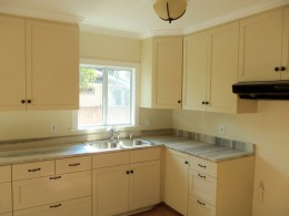 Shaker style kitchen with green marble counter top alt view 1