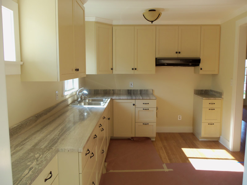 Shaker style kitchen with green marble counter top alt view 2